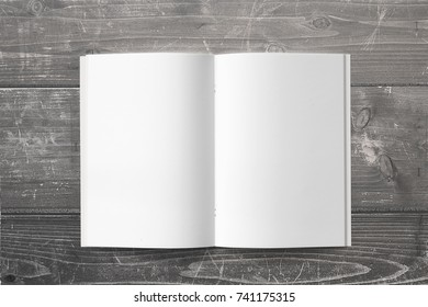 Opened Magazine or Brochure on wooden background. Blank pages top view. Mockup template for your showcase.