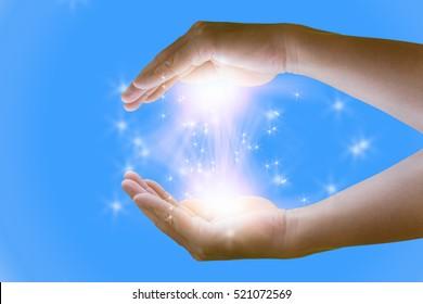 Opened magic  hand with magic lights