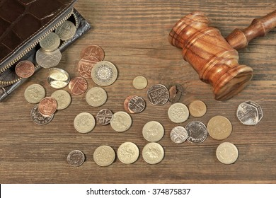 Opened Male Leather Wallet, Scattered British Different Coins And Judges Gavel On Old Rustic Rough Brown Wood Background With Copy Space, Overhead View