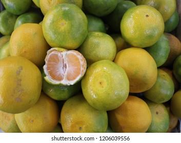 Opened mandarin orange fruit