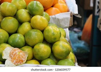 Opened mandarin orange at market