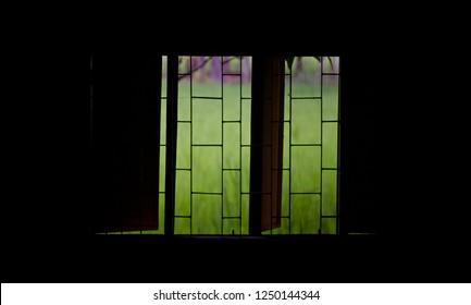 Opened metallic windows of a dark room unique photo
