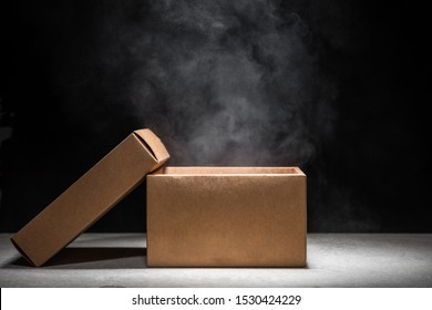 opened mystery box with smoke float up on dark background - Shutterstock ID 1530424229