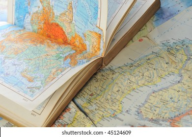 opened old atlas book on  map