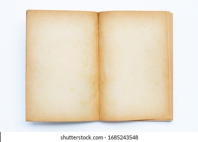 Opened old book isolated on white background.