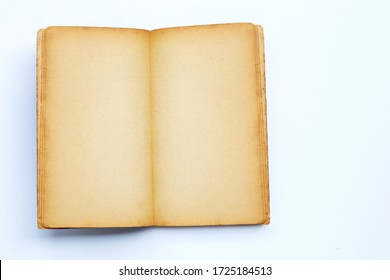 Opened old book isolated on white background. Copy space