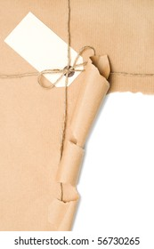Opened parcel tied with string with blank label, copy space included within torn section
