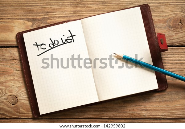 Opened personal organizer with a to do list.