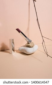 Opened rouge falling from the a stone . Abstract still life. Makeup collection 4.