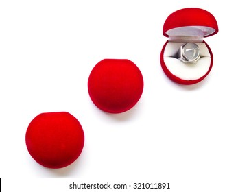 Opened round red velvet jewelry boxes isolated with space for text on white background   for luxurious, jewelry, rich, life style concept