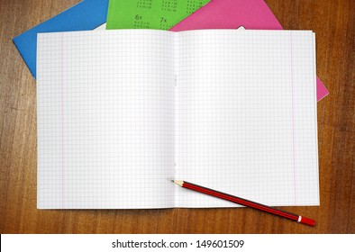 Opened school notebook and pencil on table