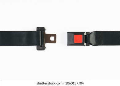 Opened seat belt isolated on white background, close-up, top view. Safety concept