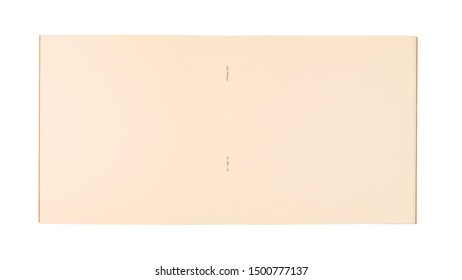 Opened square notebook with binding staples isolated on white background, yellow paper of spread notebook as background
