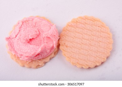 Opened strawberry cream  biscuit.