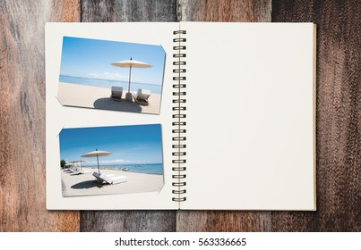 Opened summer holiday journey photo book with copy space, on wooden desk