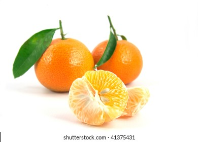 Opened tangerine with pits on white background