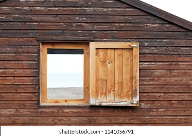 An opened timber window of a beach cabin in Whitstable, England.