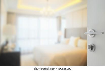 opened white door to modern bedroom interior as background