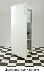 Opened white fridge on black and white floor. Front view.