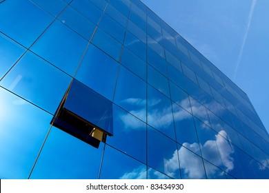 Opened window in the blue skyscraper office building