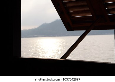 Opened window with river view in natural morning light