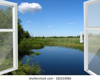 opened window to the summer lake and meadow