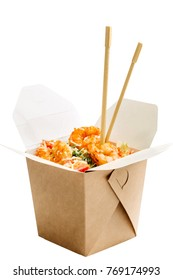 Opened WOK paper box of salad with shrimps and chopsticks. Asian fast food concept.