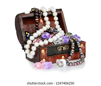 Opened wooden chest with jewels and gemstones isolated on a white background