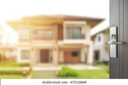 opened wooden door to modern home exterior as background