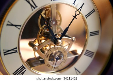 Open-gearing clock on a table, blur, shadows and lights