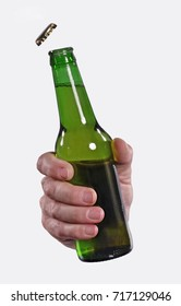 Opening beer cap bottle on white background.