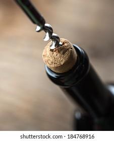 Opening a bottle of wine in celebration