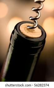 Opening a bottle of wine in celebration (shallow DOF)