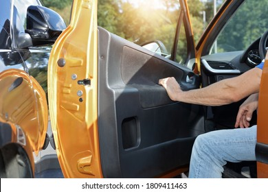 Opening car door into another car. Parking lot accident insurance concept