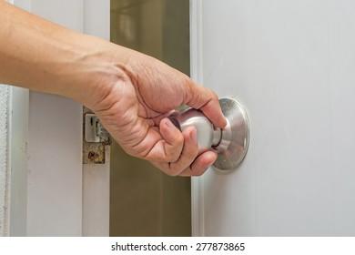 Man Hand Lock Door Knob Stock Photo (Royalty Free) 136302224 ...