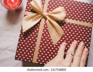 Opening gift box. Close up of gift box