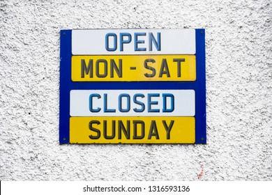 Opening hours shop sign Monday to Friday daytime closed Sunday