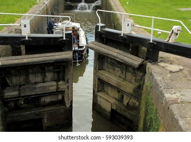 Opening the lock gates for a boat at Bath Lower Locks on the Kennet and Avon Canal in Bath, Somerset, England. The photo was taken on 26th of May, 2015.