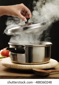 Opening steam over cooking pot and cover.