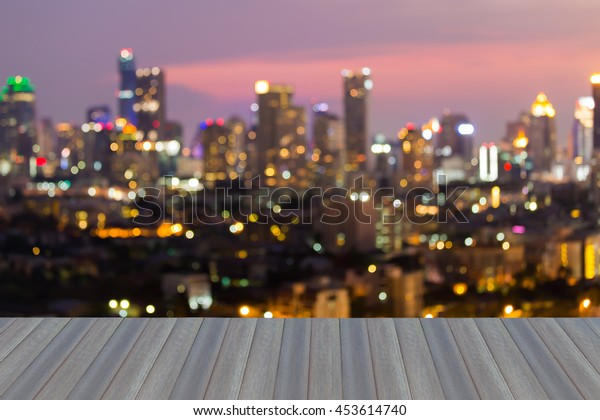 Opening wooden floor, abstract blurred bokeh big city lights night view