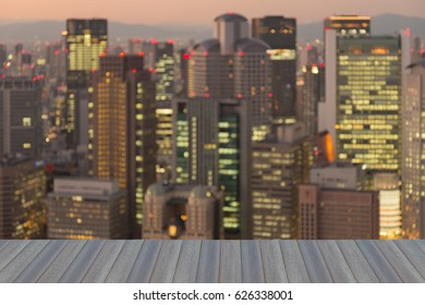 Opening wooden floor, Blurred bokeh Osaka business downtown blurred bokeh light night view, abstract background