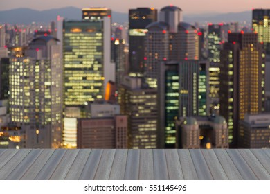 Opening wooden floor, blurred lights Osaka city office building downtown, abstract background