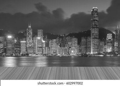 Opening wooden floor, central business downtown Hong Kong city over Victoria Bay, black and white tone