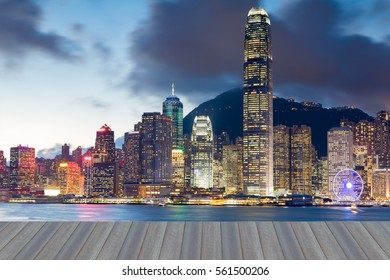 Opening wooden floor, Hong Kong office building business downtown over Victoria sea port