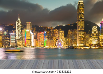 Opening wooden floor, Hong Kong blurred light office downtown, abstract background