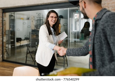 Openly greeting a job recruiter with a firm handshake