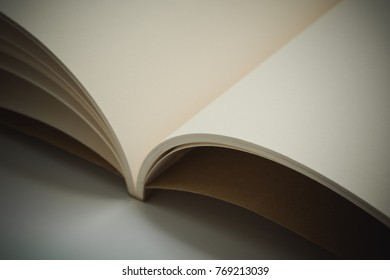 Openned blank pages of notebook on table with vintage effect style
