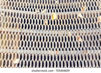 Openwork metal grille. Background rusty welt groove.