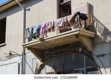 Openwork wrought-iron balcony, all hung with drying linen on one of the streets of Famagusta . Cyprus.