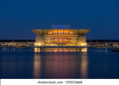 Opera house of modern Copenhagen in Denmark at night. Famous Denmark architecture at night with beautiful illumination. Opera house reflection in Copenhagen, Scandinavia. Copenhagen Opera landmark.